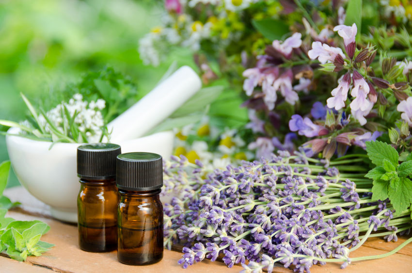 47461686 - essential oils with herbal flowers for natural therapy