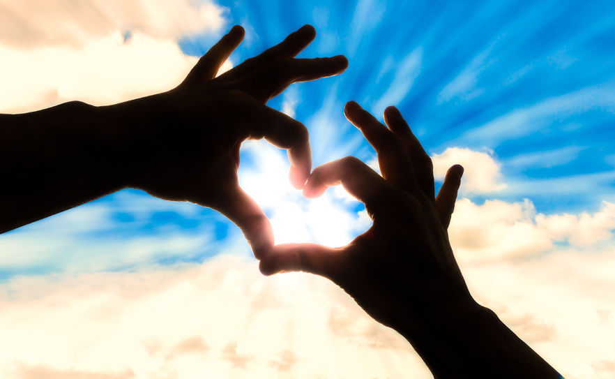 39057447 - silhouette hands in heart shape and blue sky
