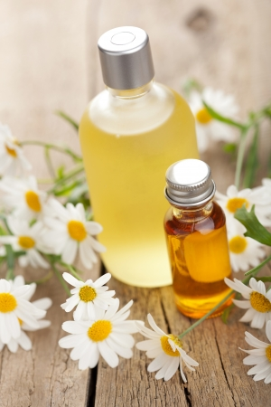 14620056 - essential oil and camomile flowers