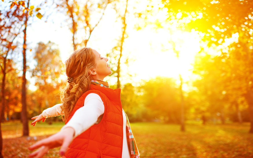 happy girl enjoying life and freedom in the autumn on nature